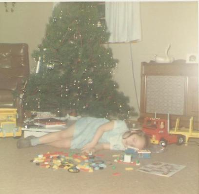Tired from playing with my new Legos, I fell asleep under the tree.